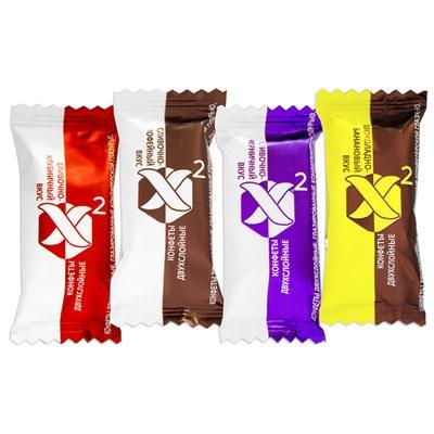Конфеты «X2» - это двухслойное суфле, сочетающее в себе насыщенные вкусы сливок и клубники, сливок и черники, сливок и кофе, шоколада и банана.